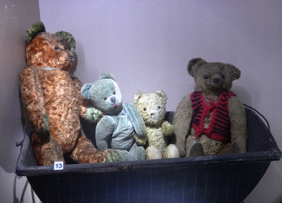 Four teddy bears in different colors. The teddy bears come from The Museum of Toys and Play in Kielce. Photo by Dorota Zoladz-Strzelczyk.